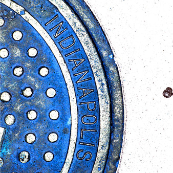 <p>Manhole cover is from Indianapolis, IN.<p><p>Click &lsquo;Choose a Product&rsquo; above to get this image handprinted on a ceramic 4x4 custom coaster, cutting board, magnet, ceramic trivet, ornament, dog tag or canvas.<p>