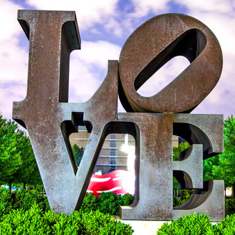 <p>Love's original rendering in sculpture was made in 1970 and is displayed in Indiana at the Indianapolis Museum of Art. The material is COR-TEN steel. Indiana's Love design has since been reproduced in a variety of formats for rendering in displays around the world.<p><p>Click &lsquo;Choose a Product&rsquo; above to get this image handprinted on a ceramic 4x4 custom coaster, cutting board, magnet, ceramic trivet, ornament, dog tag or canvas.<p>