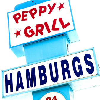 "<p>The Peppy Grill opened in 1949. You might notice the sign outside Peppy Grill advertises for ""Hamburgs."" Wilkins said in a version of the story; the original owner didn't have the money to buy a sign to fit the entire word ""hamburgers"" on it. The other account is connected to his German heritage and advertising to his customers. Customers can pick which one they like.<p><p>Click &lsquo;Choose a Product&rsquo; above to get this image handprinted on a ceramic 4x4 custom coaster, cutting board, magnet, ceramic trivet, ornament, dog tag or canvas.<p>"
