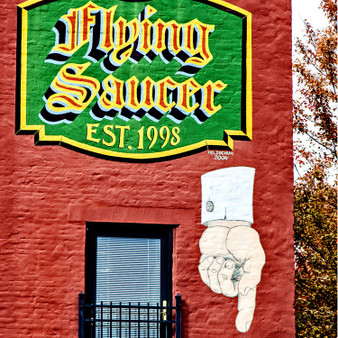 Flying Saucer is a beer bar founded in 1998 serving the craft beer to the Beerknurds — in Downtown Little Rock.