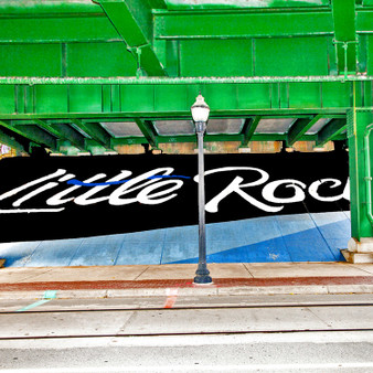 """""""Little Rock"""" was printed as a sign on the concreate of an overpass in Little Rock, AR."""