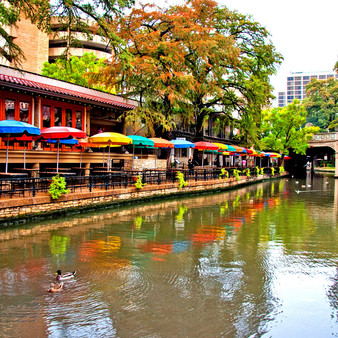 """Translated to """"Paseo del Rio"""", the San Antonio Riverwalk is a widely known city park with a series of pathways along the banks of the San Antonio River. Surrounded by bars, shops, restaurants, artwork, culture, nature, and five historic missions, the River Walk is a significant part of the city's urban fabric."""