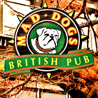 """An authentic British theme pub, Mad Dogs describes itself as a """"pub that thinks it's a club"""". Featuring Riverwalk dining, they offer a full range of draft and bottled imported beers, entertainment every day of the week, and staff members in kilts."""