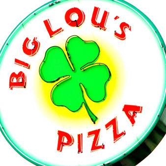 """With no prior pizza experience, Big Lou's was built based on determination to create a pizza bar that truly cared about its quality and customers satisfaction. Immediately a quick hit since its open in 2000, by 2002 Big Lou's had won accolades for their pizza, wings, and personality. In fact, one thing they're known for, as featured on the hit show """"Man vs. Food"""", is their 42"""" pizza."""