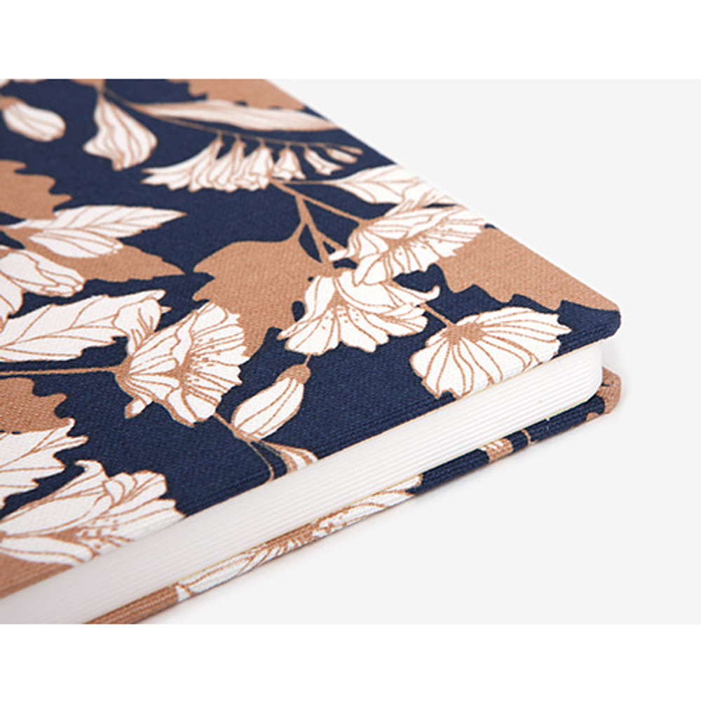 Detail of pattern fabric cover plain notebook