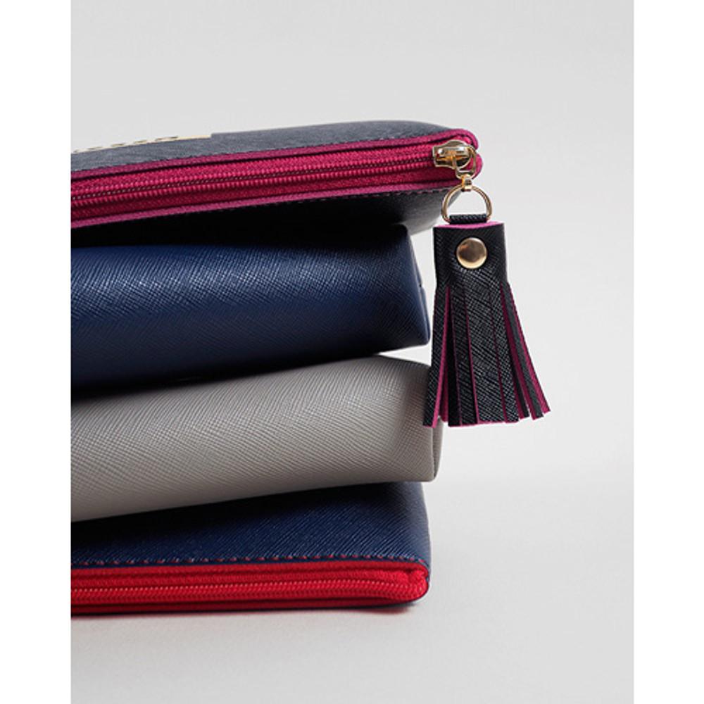 Detail of Merci tassel zipper pencil case