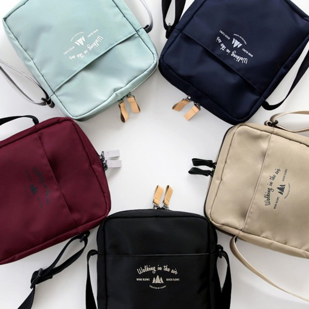 Voyager double zippered crossbody bag