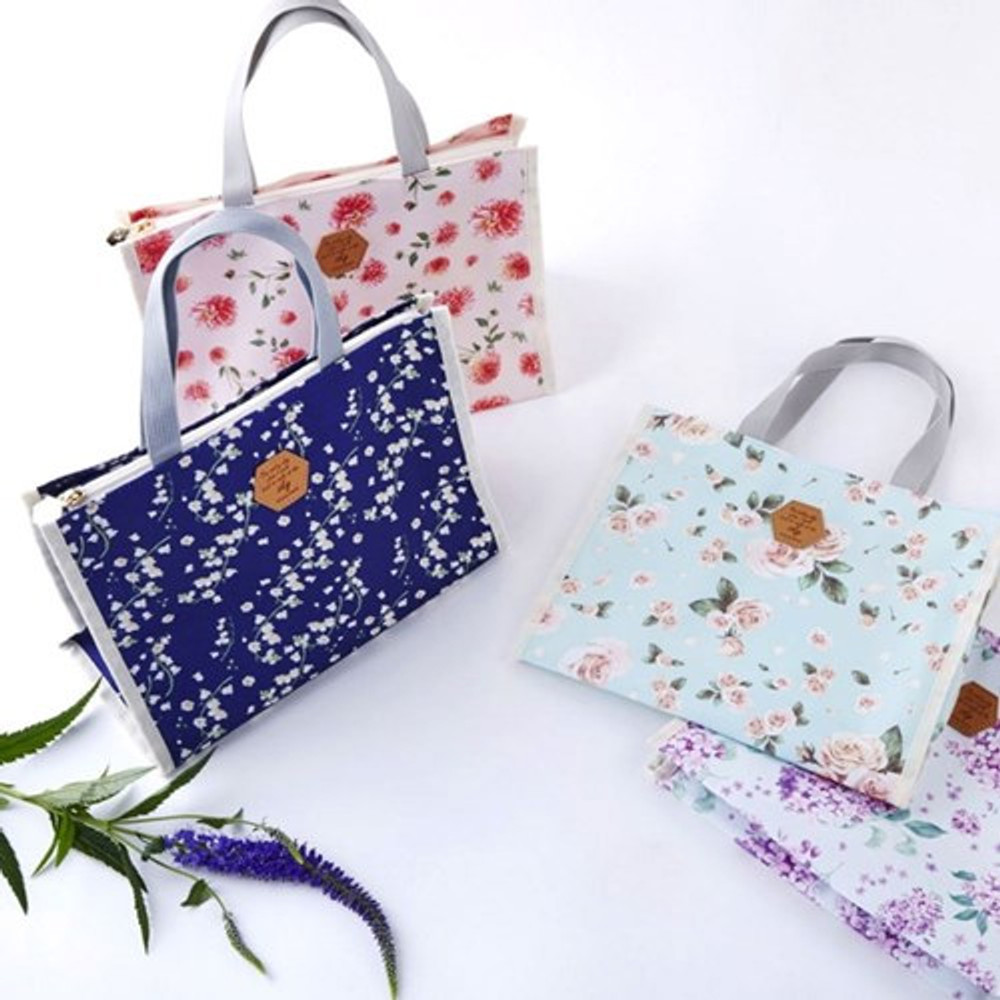 Blossom pattern multi zippered tote bag