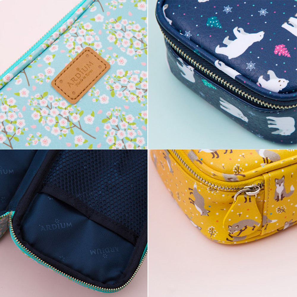 Detail of Pattern cube zip around multi pouch