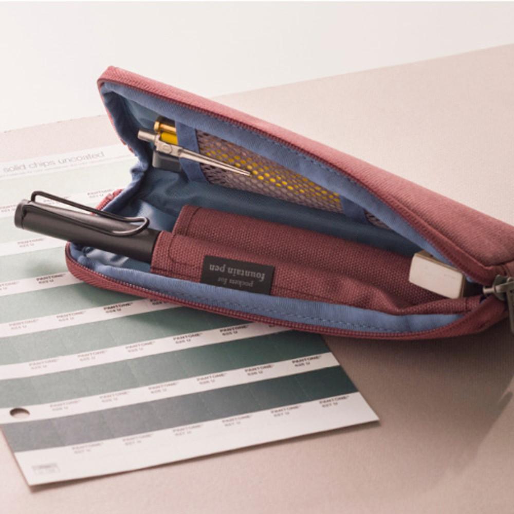 Detail of Oxford half zip around pocket pencil pouch