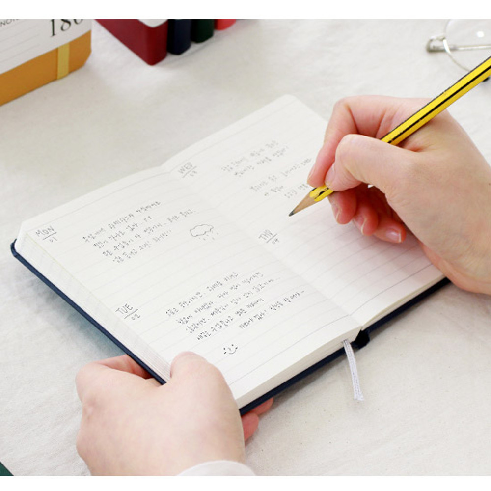 Example of use - Prism 180 pages small lined notebook with elastic band