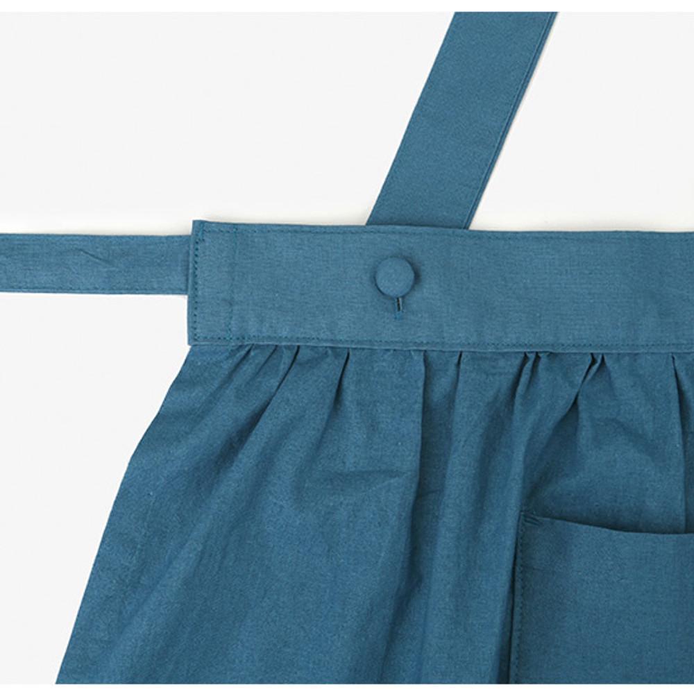 Detail of Dailylike Midnight blue frill linen cross back apron
