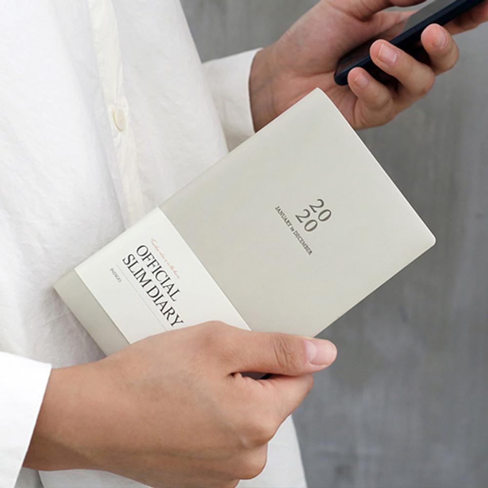Indigo Official slim dateless weekly planner notebook