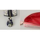 Detail of Flower pattern half moon zipper pencil case