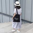 Le voyageur black cotton shoulder tote bag