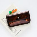 Example of use - Livework Coi clear PVC snap button clutch bag pouch