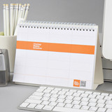 Wirebound undated weekly desk planner