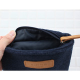 Detail of A low hill basic winter half moon pouch
