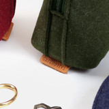 Detail of Tailorbird animal felt round pouch