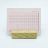 Pink squared manuscript paper postcard