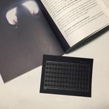 Black - squared manuscript paper postcard