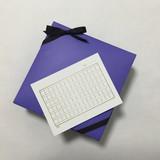 White - squared manuscript paper postcard