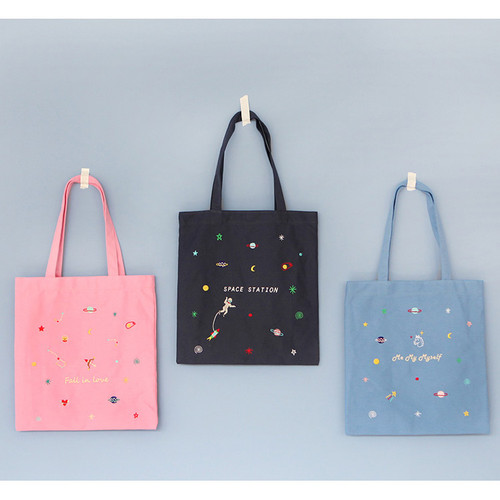 In space cotton shoulder tote bag
