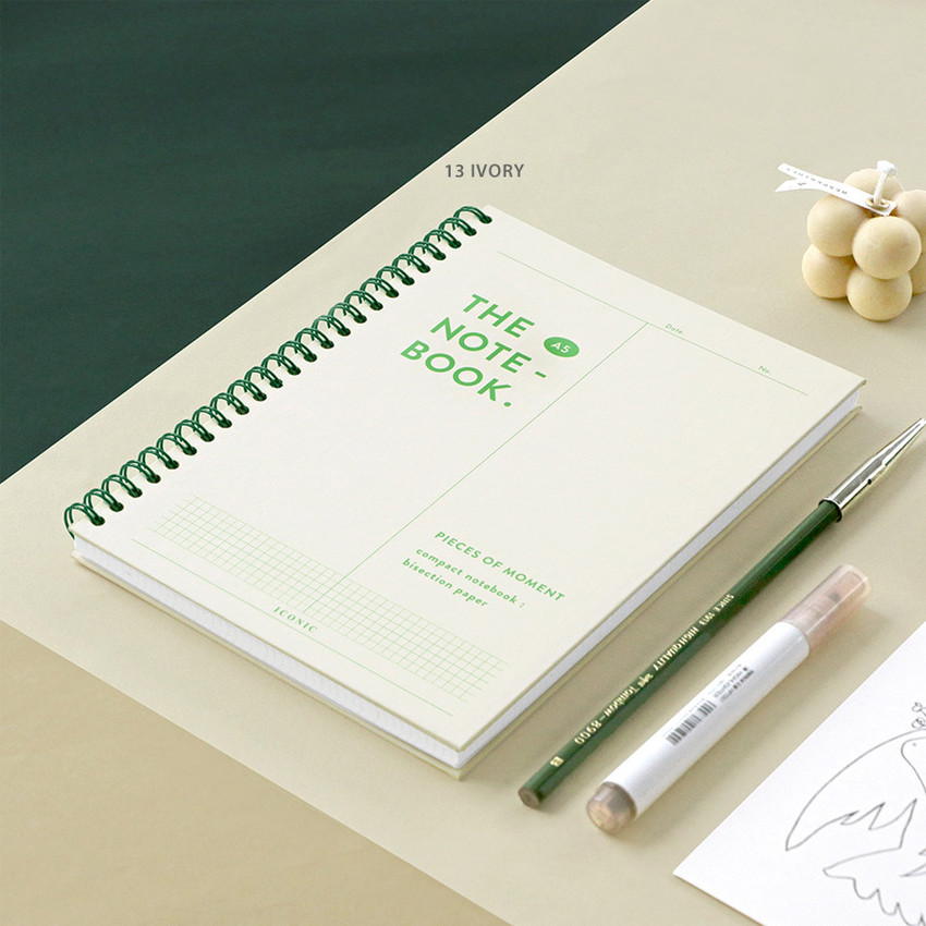 13 Ivory - ICONIC Vertically half divided wire bound A5 grid notebook