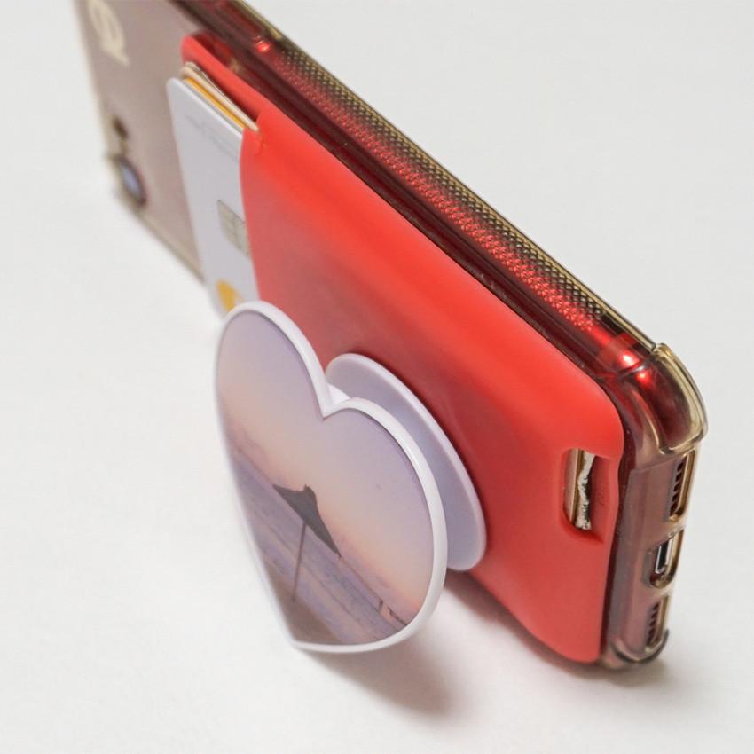 Usage example - Meri Film Pink heart sunset pop up phone grip holder