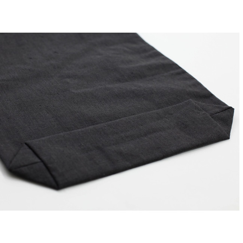 Bottom of Natural and Pure fabric gentle drawstring pouch