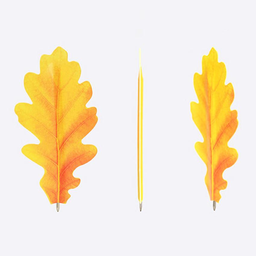 Acorn yellow leaf bookmark black ballpoint pen