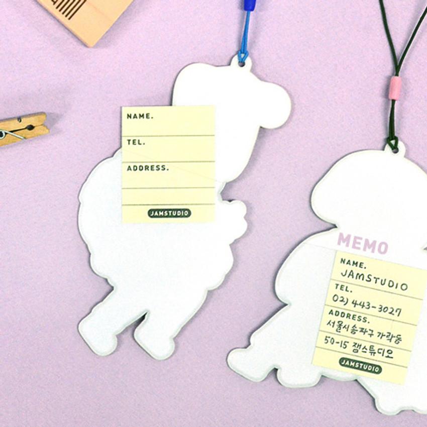 The back of Du dum boy travel luggage name tag