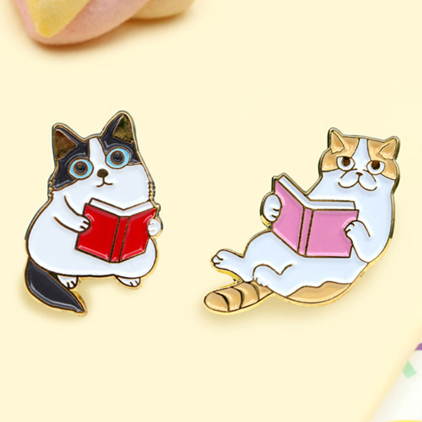 Detail of Lovely cat reading a book badge