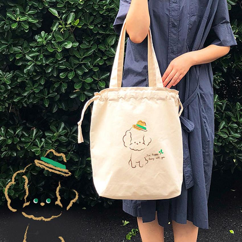 Example of use - Antenna Shop Poodle cotton drawstring shoulder bag