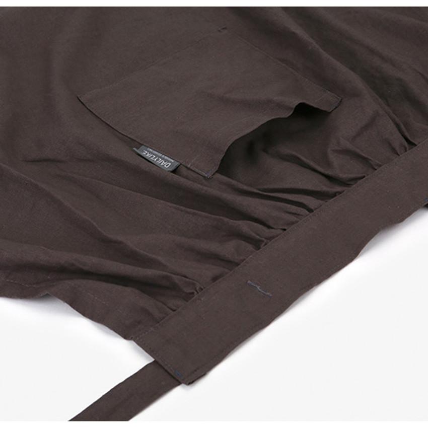 Detail of Dailylike Shadow gray frill linen cross back apron