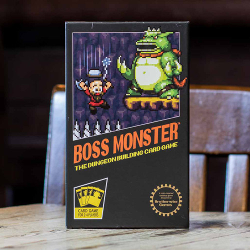Mox Boarding House | Front cover of Boss Monster, a two to four player game.