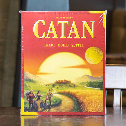 Mox Boarding House | Front of Catan, the classic strategy board game for three to four players.