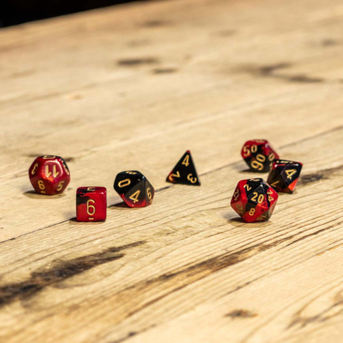 Chessex #26433 - Gemini Black-Red / Gold Polyhedral (7ct)