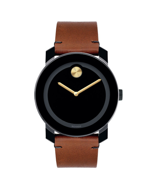 Large Movado BOLD watch, 42 mm black TR90 composite material and stainless steel case, black dial with yellow gold-toned sunray dot and hands, cognac Colorado bull hide leather strap with black tack-stitch detail and black ion-plated stainless steel buckle, K1 crystal, Swiss quartz movement, water resistant to 30 meters.