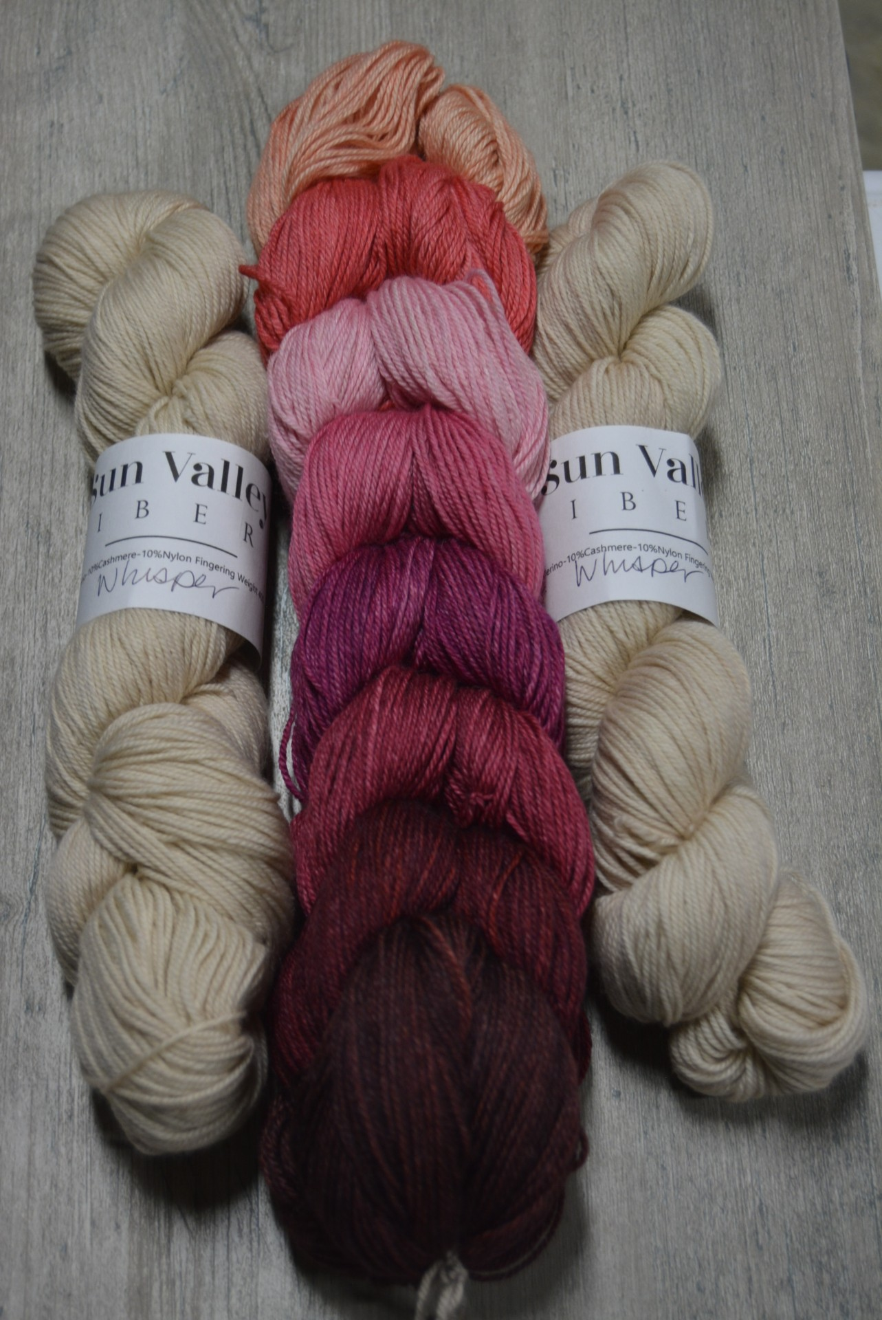 Painted Bricks in Pinks contains 8   100 yard skeins of the following colors:  Etude, Coral, Blush, Persuasion, Berries, Annie, Mulberry, Intermission And also 2  400 yard skeins of Whisper