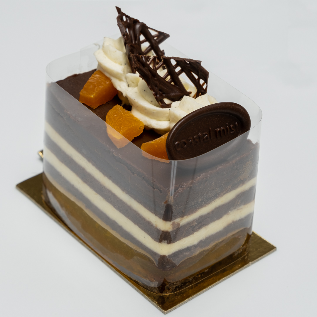 Apricot syrup soaked chocolate sponge cake, with apricot gelee, and apricot mousse layered atop a dark chocolate brownie. Finished with dark chocolate glaze.