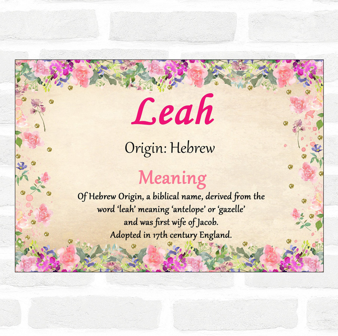 Image ID: The name Leah written in cursive over a floral background. The text beneath reads: Origin: Hebrew. Meaning: Of Hebrew origin, a biblical name, derived from the word leah meaning antelope or gazelle and first wife of Jacob. Adopted in 17th century England.