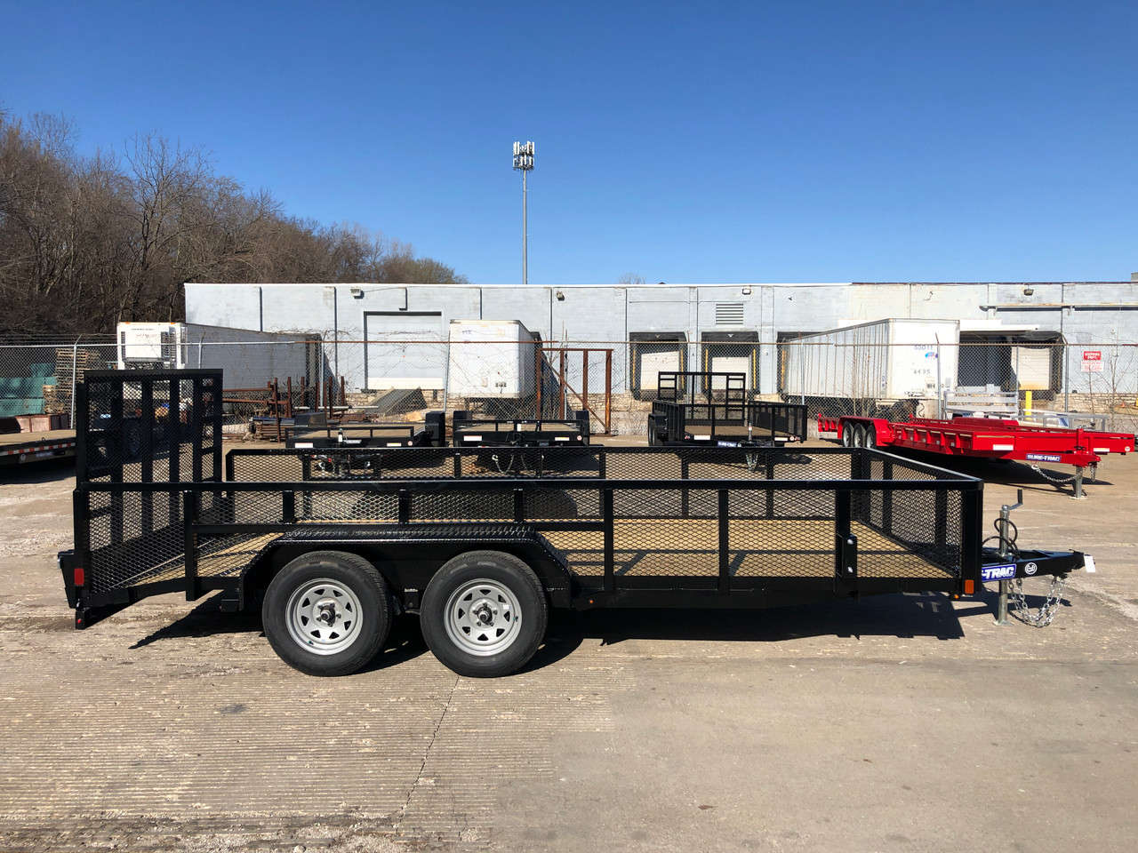"""STR8216LS-E2 --- 2021 Sure-Trac 82"""" x 16' Landscape Trailer with 2' Mesh Sides and Ramp Gate - ST5107"""