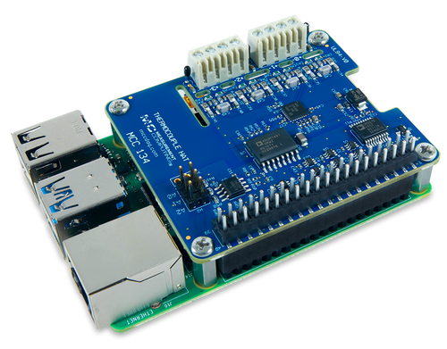 The MCC 134 Thermocouple Measurement DAQ HAT for Raspberry Pi®, displayed at an angle on top of a Raspberry Pi (Raspberry Pi sold separately).