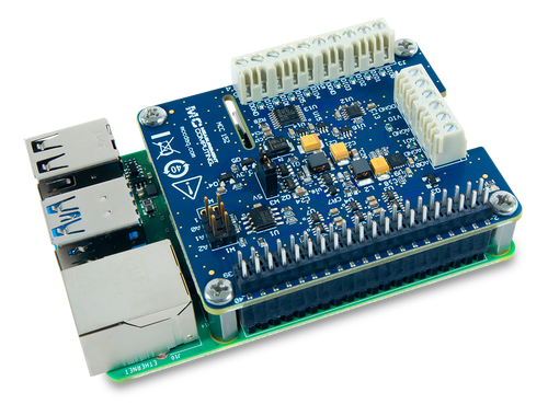 The MCC 152 Voltage Output and DIO DAQ HAT for Raspberry Pi®, displayed at an angle on top of a Raspberry Pi (Raspberry Pi sold separately).