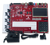 Product image of the Anvyl Spartan-6 FPGA Trainer Board with the included power supply and USB cable. Pmod clips are not included.