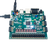 Product image of the Nexys 4 Artix-7 FPGA Trainer Board with the included USB cable plugged in. External power supply is not included.