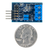 Size comparison product image of the Pmod PMON1: Power Monitor and a US quarter (diameter of quarter: 0.955 inches [24.26 mm]; width: 0.069 inches [1.75 mm]).