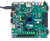 Product image of the Nexys Video Artix-7 FPGA: Trainer Board for Multimedia Applications in use with the included power supply.