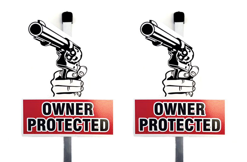 Owner protected yard sign with gun